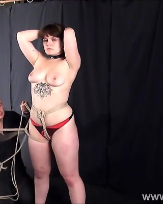 Amateur bondage and homemade suspension of dominated submissive in restrained ropes and bound babe in the dungeon