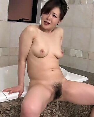 Mature Asian babe washes his junk