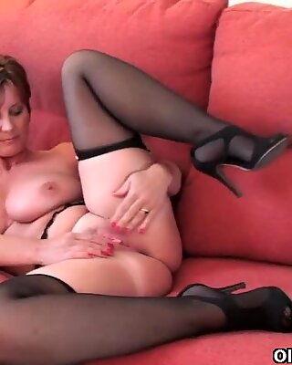 Gorgeous granny with big tits shows her fuckable body