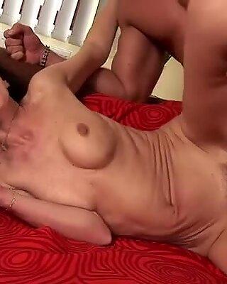 Old slutty cougar Oktavia sucks and fucks young hadnsome Alex