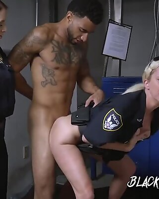 Horny female cops suck big black cock of suspect