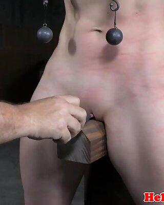 BDSM slave gets restrained in dark dungeon