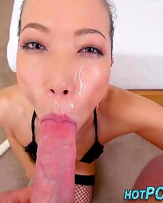 Asian slut gobbles cock