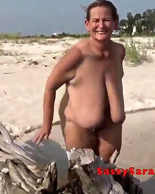 Sun sea surf and a pair of massive hanging tits