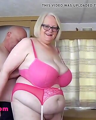 Huge tits granny in sexy stockings and suspenders