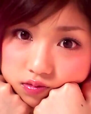 Fantastically sexy babe Yuko Ogura wears fancy outfit and poses on cam
