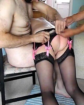Two masters spank hooded mature slut OTK