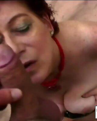 A slutty chubby redhead granny rubs her vagina then blows man s stiff penis